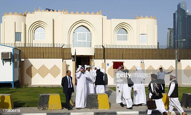 Guests arrive for the opening ceremony of the new Taliban political office in Doha on June 18 2013 The office is intended to open dialogue with the...