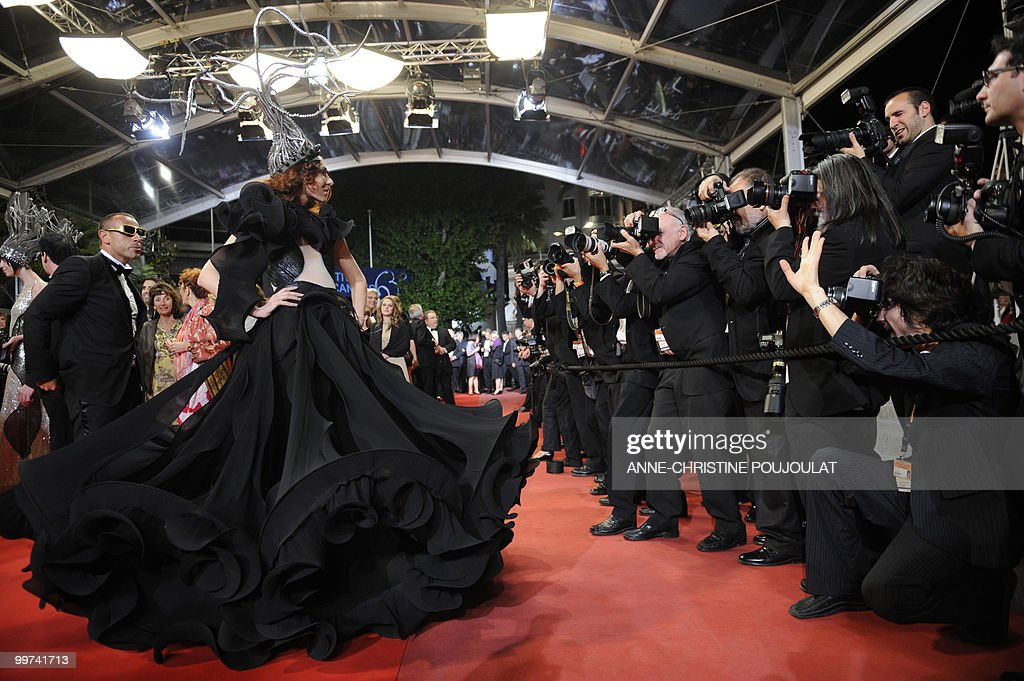 Guests arrive for the screening of 'Outrage' presented in competition at the 63rd Cannes Film Festival on May 17, 2010 in Cannes.