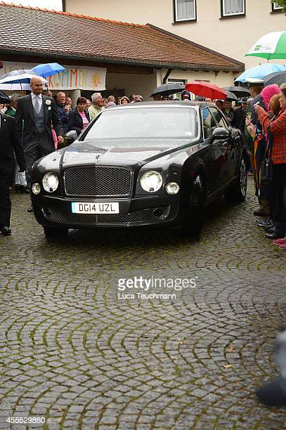 Guests arrive for the wedding of Maria Theresia Princess von Thurn und Taxis and Hugo Wilson at St Joseph Church in Tutzing on September 13 2014 in...