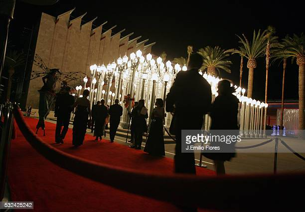 Guests arrive in front of artist Chris Burden's installation Urban Light 20002007 at the LACMA's Gala Opening celebration of the Broad Contemporary...