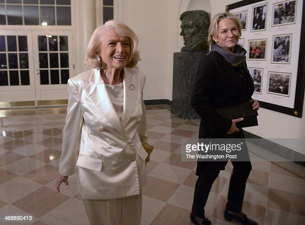 Guests arrive, including Edie Windsor, center, and Julie Milligan, right, for the state dinner in honor of French President Hollande, on February...