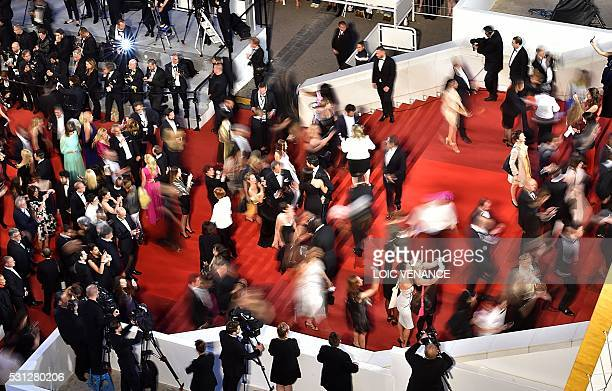 TOPSHOT Guests arrive on May 13 2016 for the screening of the film 'La Danseuse ' at the 69th Cannes Film Festival in Cannes southern France / AFP /...