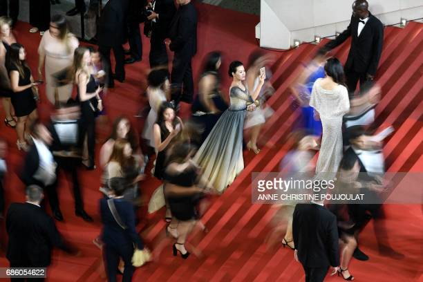 TOPSHOT Guests arrive on May 20 2017 for the screening of the film 'The Square' at the 70th edition of the Cannes Film Festival in Cannes southern...
