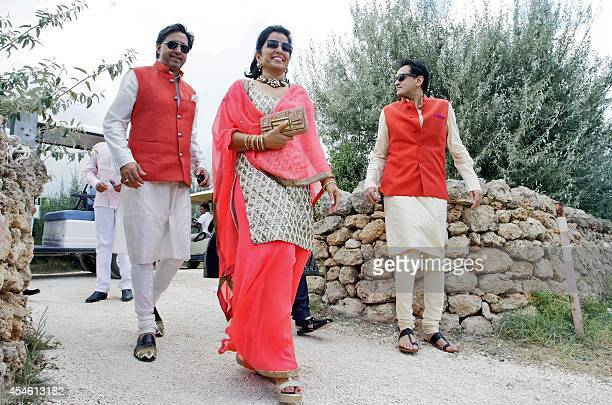 Guests arrive to a beach close to the tiny village of Savelletri di Fasano on September 4 2014 to attend the wedding of Ritika Agarwal daugther of...