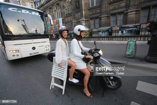 Guests arrive to the 29th Annual Diner En Blanc at the Paris City Hall Square on June 8 2017 in Paris France The Diner En Blanc is a worldwide event...
