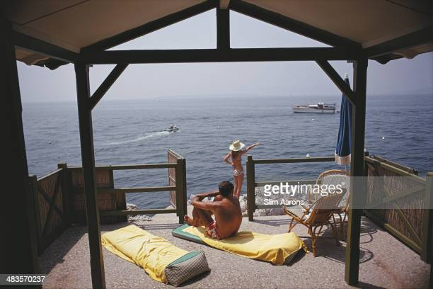 Guests at a beach hut at the Hotel du CapEdenRoc in Antibes on the French Riviera August 1969