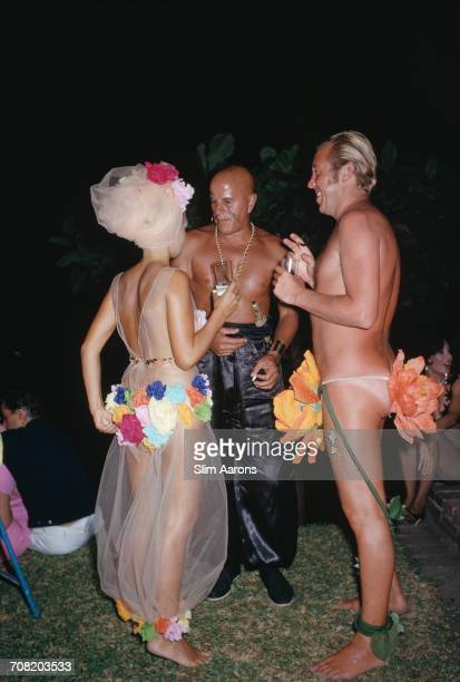 Guests at a fancy dress beach party in Acapulco Mexico February 1966