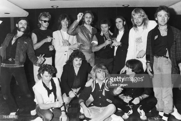 Guests at a farewell party for British rock band Status Quo 1984 Back row left to right Lemmy of Motorhead Roger Taylor of Queen Andy Bown of Status...