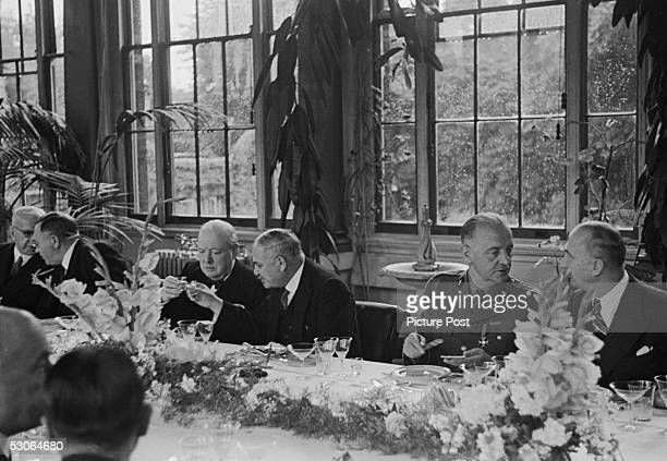 Guests at a lunch party in the Winter Garden of the Soviet Embassy in London given by Soviet Ambassador Ivan Maisky August 1941 Maisky clinks glasses...
