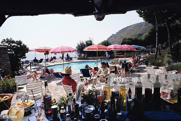 Guests at a poolside bar at the Hotel Il Pellicano in Porto Ercole Tuscany August 1980