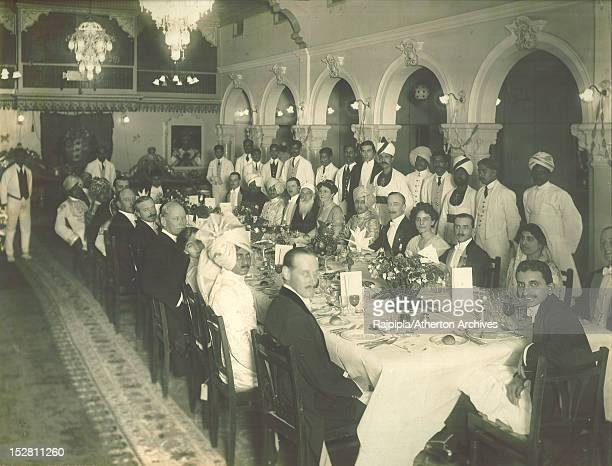Guests at a state banquet given at Vijay Palace Rajpipla Gujarat India during the state visit of the British Governor of Bombay Freeman FreemanThomas...