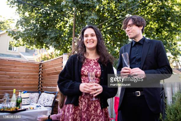 """guests at a wedding cocktail backyard party during covid-19. - """"martine doucet"""" or martinedoucet stock pictures, royalty-free photos & images"""