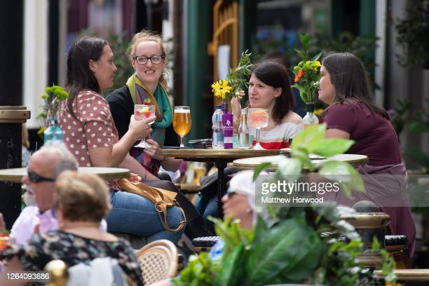 Guests at Gin and Juice gin bar on August 5, 2020 in Cardiff, United Kingdom. Coronavirus lockdown measures continue to be eased as the number of...