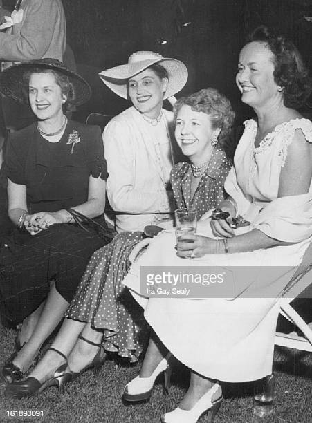 JUL 22 1949 Guests at one of the week's fashionable cocktail parties included this foursome Mrs Whitford Gould Miss Caroline Bancroft Mrs William E...