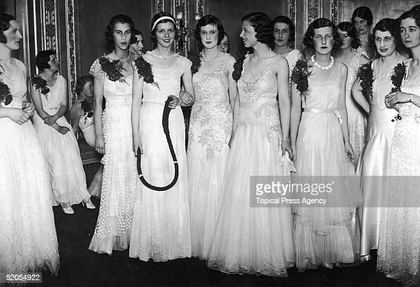 Guests at Queen Charlotte's birthday ball at the Dorchester Hotel, London, May 1931.