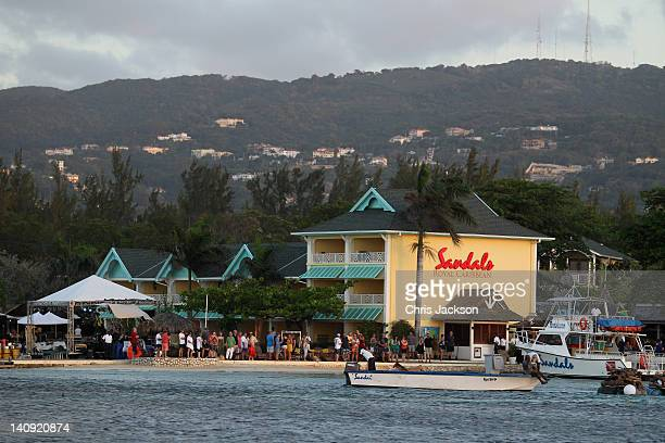 Guests at Sandals look on as Prince Harry attends a reception on a private island at Sandals Resort on March 7 2012 in Montego Bay Jamaica Prince...