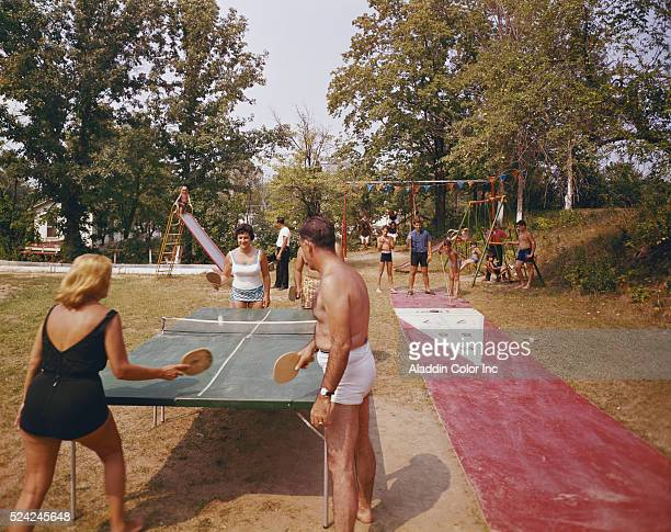 Guests at the Belvedere Manor playing shuffleboard and ping pong