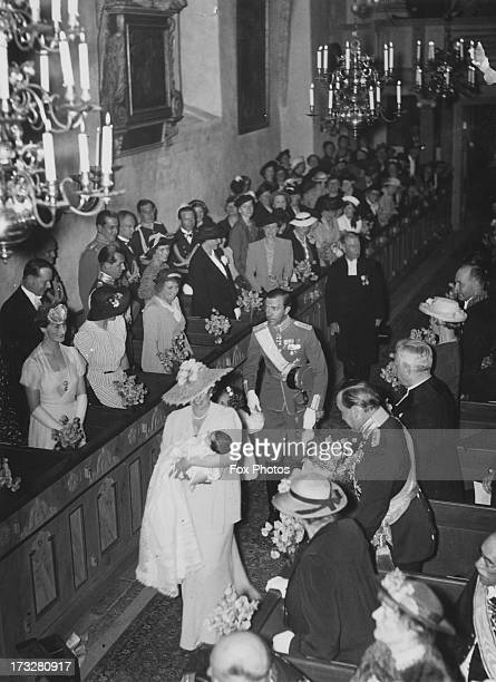 Guests at the christening service for Princess Desiree Baroness Silfverschiold in Solna Church Stockholm 30th June 1938 Princess Desiree is being...