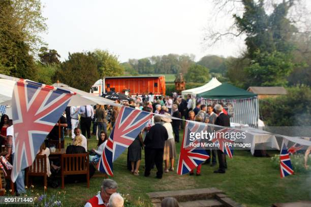 Guests at the invitationonly party at the Boot Inn in Bucklebury celebrate the wedding of Prince William and Kate Middleton the new Duke and Duchess...