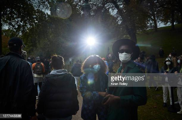 Guests at the Koche Womenswear Spring/Summer 2021 show in the Jardin des Buttes Chaumont on the first day of Paris Fashion Week on September 29, 2020...