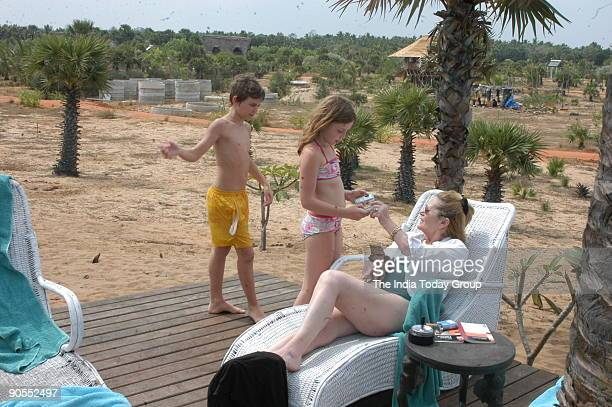 Guests at the Swimming Pool in The Dune Beach Village near Pondicherry