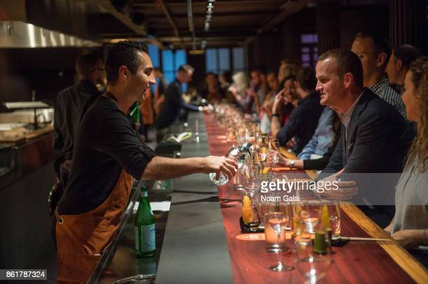 Guests attend a dinner with Masa Takayama as part of the Bank of America Dinner Series presented by The Wall Street Journal during Food Network...