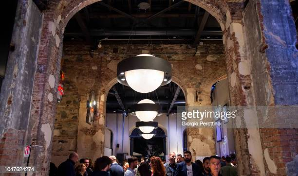 Guests attend a djset during the event called 'Baustelle La fine dell'amore la fine della violenza Amen @OGR' at Officine Grandi Riparazioni on...