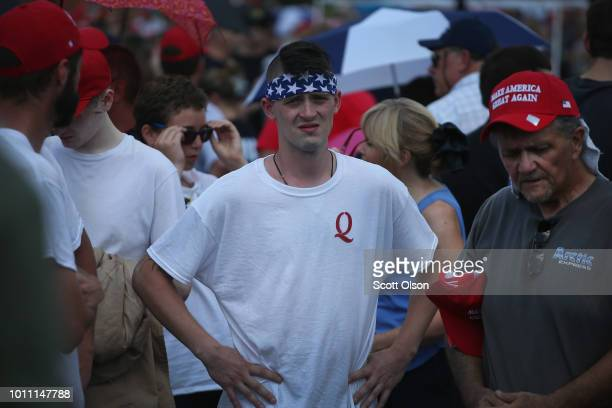 Guests attend a rally where President Donald Trump was speaking to show support for Ohio Republican congressional candidate Troy Balderson on August...