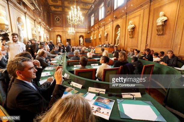 Guests attend a session on the presentation of the campaign themed 'Ensemble pour un pays de lecteurs' held by French Education Minister JeanMichel...