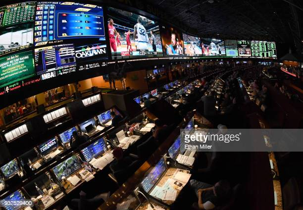 Guests attend a viewing party for the NCAA Men's College Basketball Tournament inside the 25,000-square-foot Race & Sports SuperBook at the Westgate...