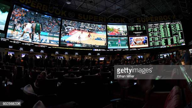 Guests attend a viewing party for the NCAA Men's College Basketball Tournament inside the 25000squarefoot Race Sports SuperBook at the Westgate Las...