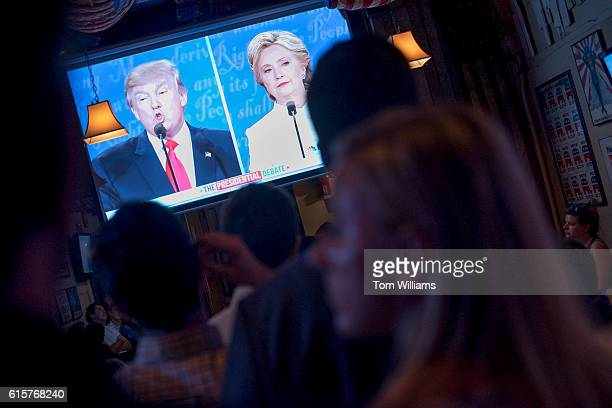 Guests attend a watch party for the last presidential debate between Donald Trump and Hillary Clinton at Capitol Lounge on Pennsylvania Avenue SE...