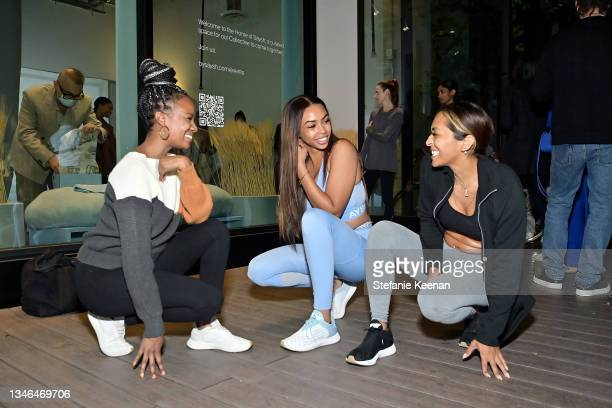 Guests attend a work out led by Megan Roup from The Sculpt Society as Olympian Allyson Felix opens Saysh's new experiential space on October 13, 2021...