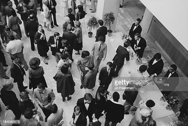 Guests attend an exhibition opening at the Museum of Modern Art New York City 1984