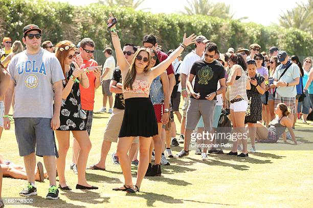Guests attend day 1 of the 2013 Coachella Valley Music Arts Festival at the Empire Polo Club on April 12 2013 in Indio California