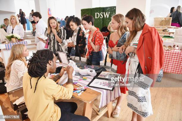 Guests attend DSW Block Party hosted by Olympians Adam Rippon and Mirai Nagasu on June 27 2018 at Ramscale Studio in New York City