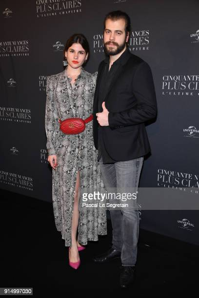 Guests attend 'Fifty Shades Freed 50 Nuances Plus Claires' Premiere at Salle Pleyel on February 6 2018 in Paris France