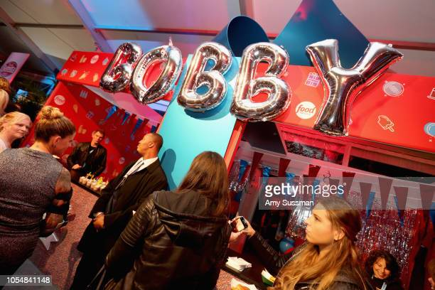 Guests attend Food Network's 25th Birthday Party Celebration at the 11th annual New York City Wine Food Festival at Pier 92 on October 13 2018 in New...