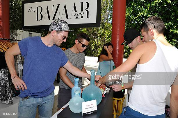 Guests attend Harper's BAZAAR Coachella poolside fete at the Parker Palm Springs on April 12 2013 in Palm Springs California