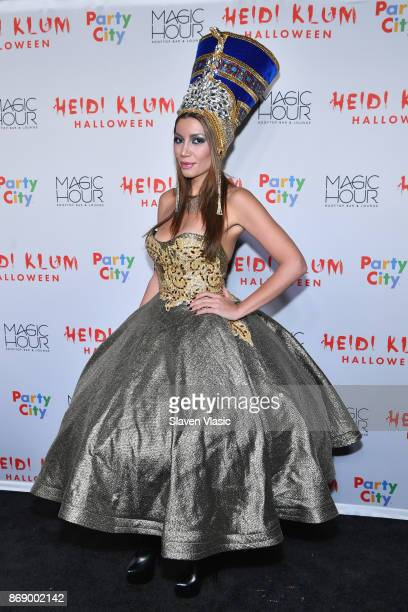 Guests attend Heidi Klum's 18th Annual Halloween Party presented by Party City and SVEDKA Vodka at Magic Hour Rooftop Bar Lounge at Moxy Times Square...