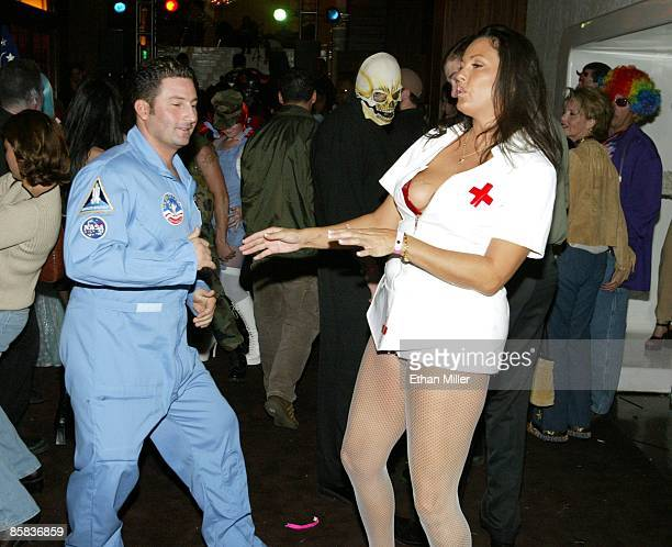 Guests attend Nylon Magazine's Halloween party at the Whiskey Sky nightclub at the Green Valley Ranch Station Casino October 31, 2002 in Henderson,...