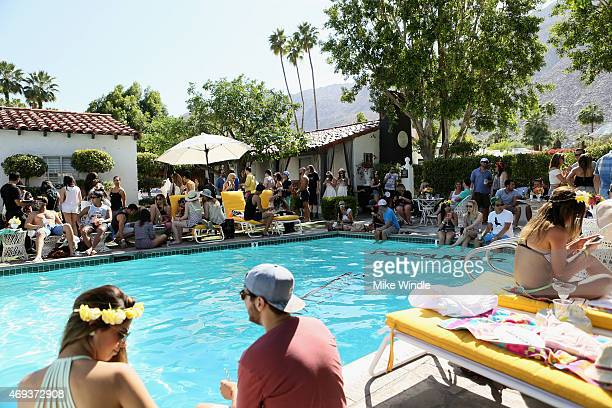 Guests attend POPSUGAR SHOPSTYLE'S Cabana Club Pool Parties Day 1 at the Avalon Hotel on April 11 2015 in Palm Springs California
