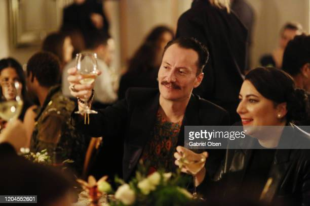 Guests attend Red Carpet Green Dress at the Private Residence of Jonas Tahlin CEO of Absolut Elyx on February 06 2020 in Los Angeles California