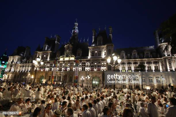 Guests attend the 29th Annual Diner En Blanc at the Paris City Hall Square on June 8 2017 in Paris France The Diner En Blanc is a worldwide event in...