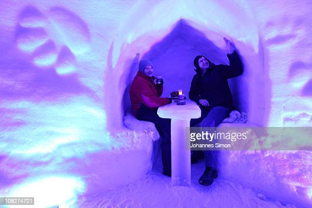 Guests attend the Alpeniglu Hotel ice bar at Hochbrixen on January 23 2011 in Brixen im Thale Austria The hotel is built completely of snow and ice...