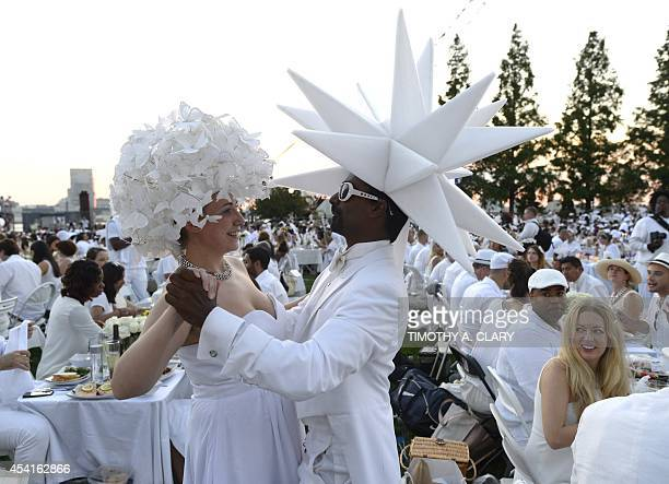 Guests attend the annual Diner en Blanc at Nelson A Rockefeller Park in Battery Park City August 25 2014 The Diner en Blanc the worlds only viral...
