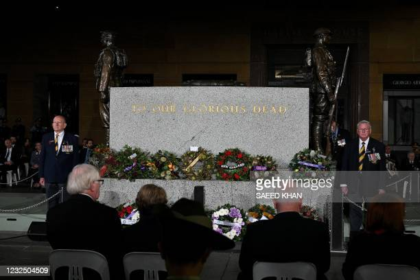 Guests attend the Anzac Day dawn service in Sydney on April 25, 2021. - Dawn services were held across the two countries on the anniversary of the...