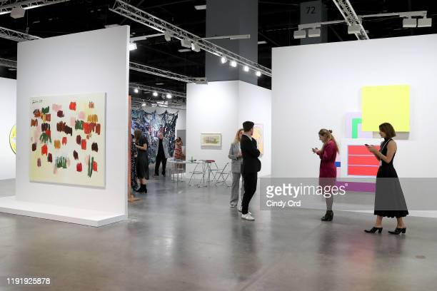 Guests attend the Art Basel Miami Beach VIP Preview 2019 at Miami Beach Convention Center on December 04, 2019 in Miami Beach, Florida.