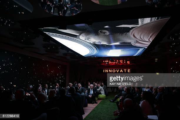 Guests attend the Axel Springer Award for Facebook founder and chief Mark Zuckerberg in Berlin on February 25 2016 Facebook announced it was donating...