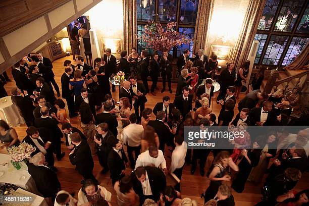 Guests attend the Bloomberg Vanity Fair White House Correspondents' Association dinner afterparty in Washington DC US on Saturday May 3 2014 The WHCA...